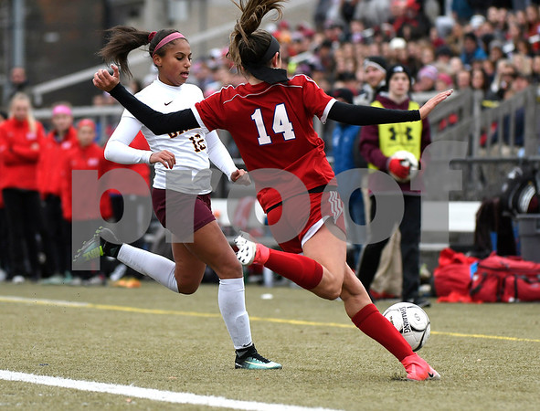 11/18/2017 Mike Orazzi | Staff Granby Memorial's Samantha St. Pierre (12) and Berlin's Emma Norton (14) during the Class M Final at Municipal Stadium in Waterbury Saturday. Granby won 3-0.