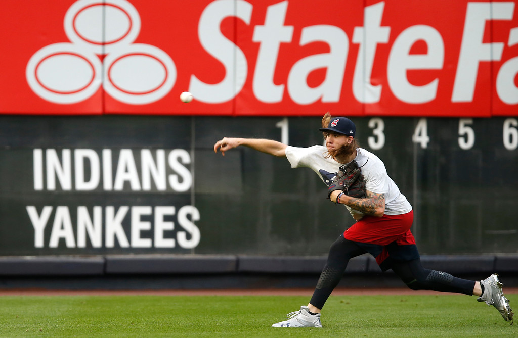 . Cleveland Indians starting pitcher Mike Clevinger throws on the field before an American League Division Series baseball game between the New York Yankees and the Cleveland Indians in New York, Monday, Oct. 9, 2017. (AP Photo/Kathy Willens)