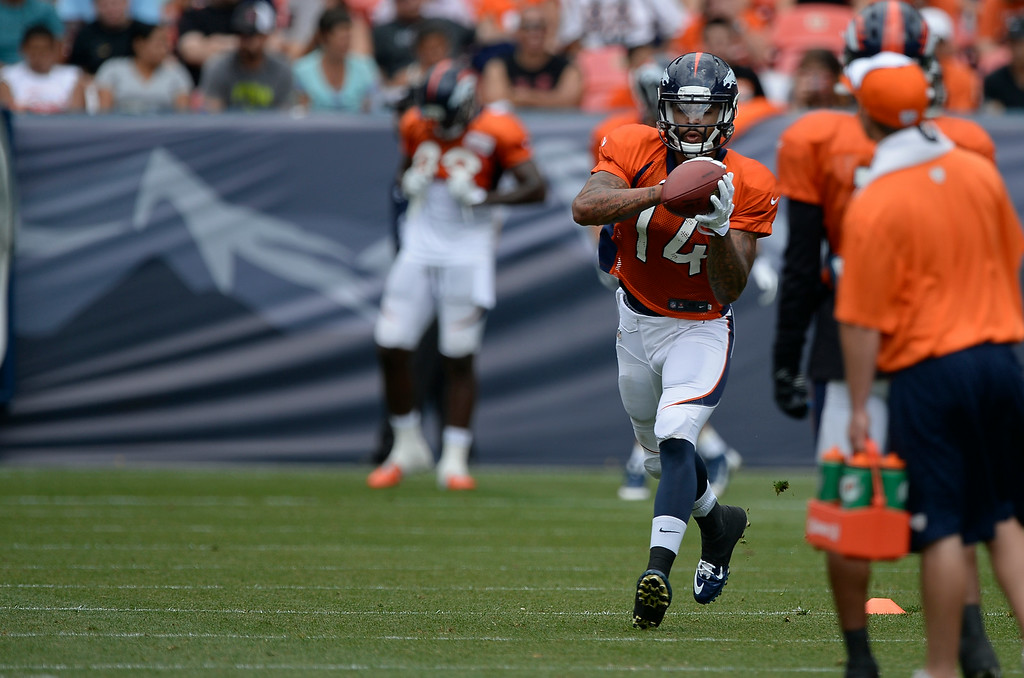 . Denver Broncos wide receiver Cody Latimer (14) catches a pass during drills on day four of the Denver Broncos 2014 training camp July 27, 2014 at Sports Authority Field at Mile High. (Photo by John Leyba/The Denver Post)