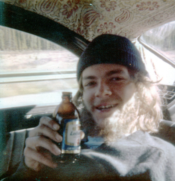 Gary drinking Labatts Blue Label in back of Volvo PV-544 - Canada trip, 1975