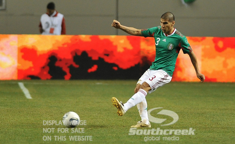 Mexico's Defender Carlos Salcido (#3) passes the ball in Soccer action between Bosnia-Herzegovina and Mexico.  Mexico defeated Bosnia-Herzegovina 2-0 in the game at the Georgia Dome in Atlanta, GA.