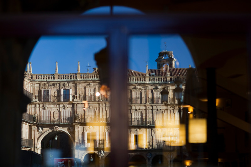 Reflections on a bar window, Plaza Mayor (Main Square), town of Salamanca, autonomous community of Castilla and Leon, Spain