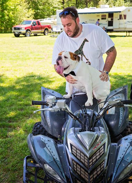 Randy putting dog on atv.jpg