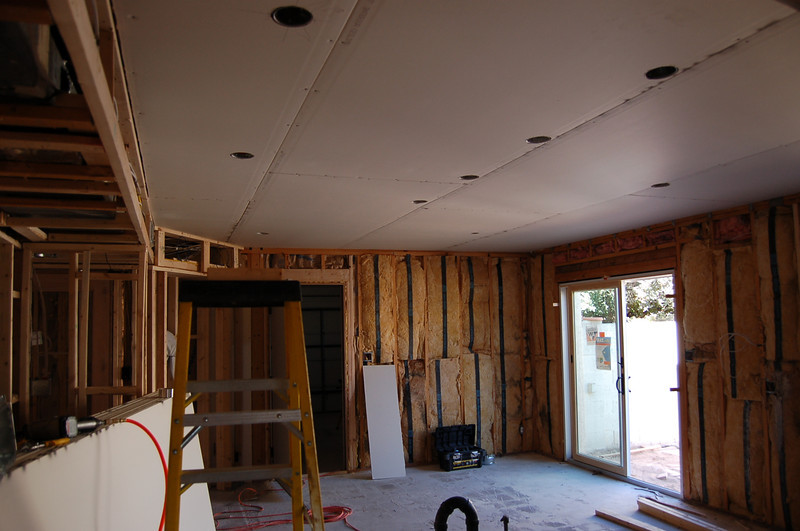 The kitchen ceiling is drywalled.