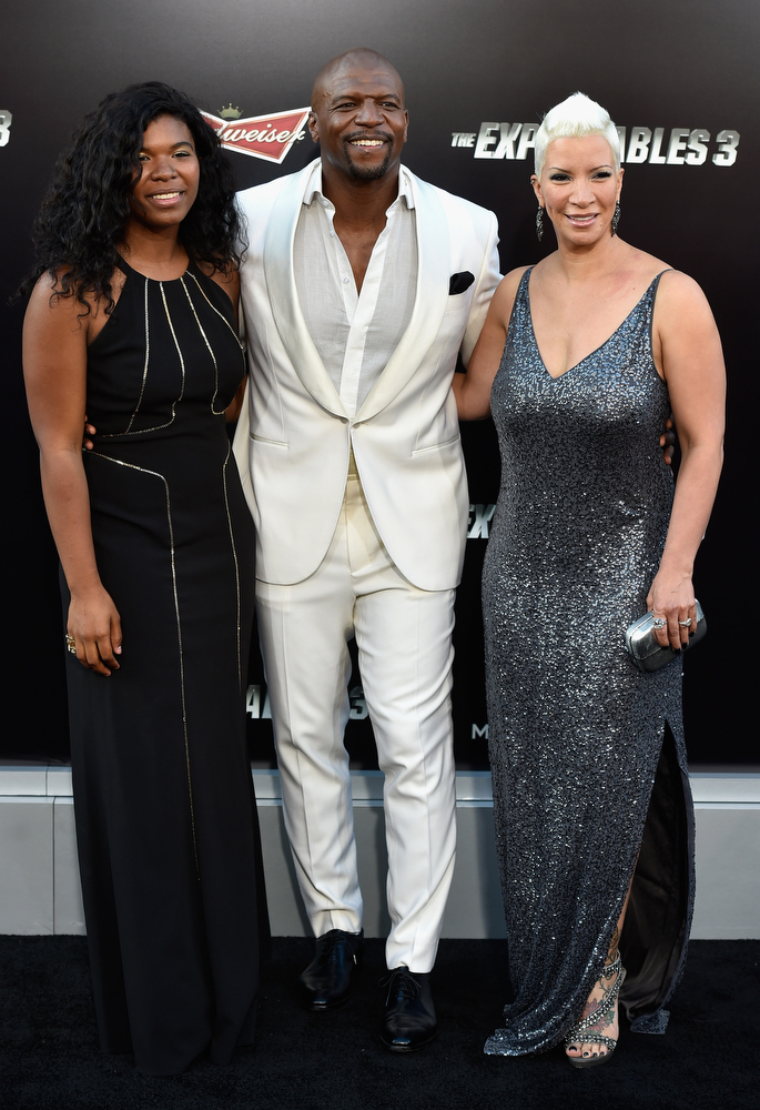 """. Actor Terry Crews and Rebecca King-Crews attend Lionsgate Films\' \""""The Expendables 3\"""" premiere at TCL Chinese Theatre on August 11, 2014 in Hollywood, California.  (Photo by Frazer Harrison/Getty Images)"""
