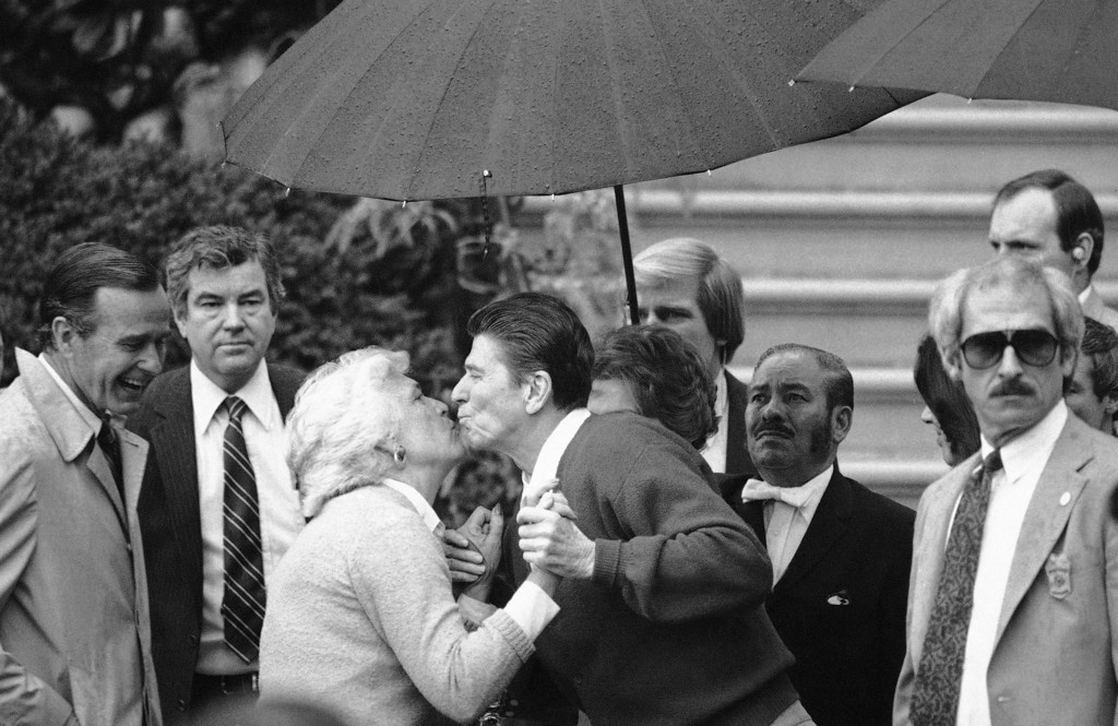 . President Ronald Reagan is welcomed back to the White House by Barbara Bush, wife of the Vice President in Washington, April 11, 1981. Reagan was released from the hospital 12 days after he was shot in the chest by a would-be assassin. (AP Photo)