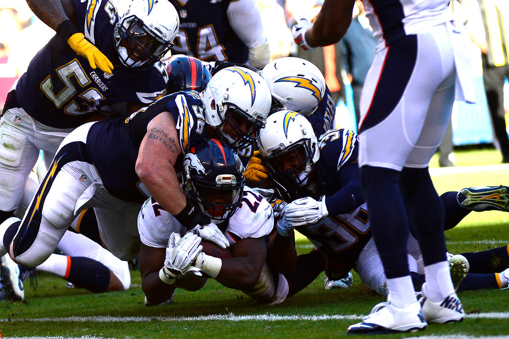 . SAN DIEGO, CA. December 14, - running back C.J. Anderson #22 of the Denver Broncos is stopped on the one late in the first half vs the San Diego Chargers at Qualcomm Stadium December 14, 2014 San Diego, CA (Photo By Joe Amon/The Denver Post)