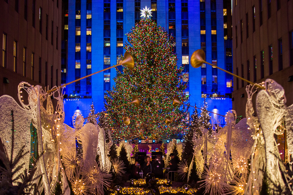 . The Rockefeller Center Christmas tree stands lit as people take photos of it and the holiday decorations at Rockefeller Center during the 85th annual Rockefeller Center Christmas tree lighting ceremony, Wednesday, Nov. 29, 2017, in New York. (AP Photo/Andres Kudacki)