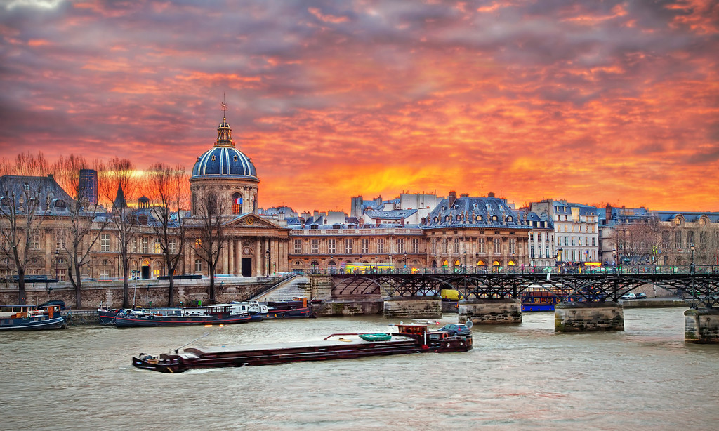 "<h2>InSeine Sunset</h2> My first time in France, first gaze upon the Seine river - and first full view of this gorgeous city so full of art, history and promise. It even had proper lighting, which I thought was very considerate. Just heavenly! So I made it look the way it felt.  I couldn't believe this sunset. People said it was unusual, but it was my first time in Paris, so how would I know? The thought did cross my mind; ""Gee, it's just like the Glenshire Pond!"". Then realized I'd probably committed some kind of mental crime de comparison.    The bridge is the Pont des Arts. It was a tit bit nippily in December when we were there. Snapping this shot in all my layers and full length down coat I could hardly imagine it - but during the summer it becomes a ""studio en plein air"" - a spot for painters, photographers, and other artists, and a picnic grounds for locals.   Hey - let's go there then! Wanna?"