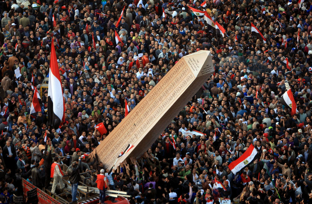 Description of . Egyptian protesters carry an obelisk with the names of those killed during last year's uprising, at a huge rally in Tahrir Square on January 25, 2012, marking the first anniversary of the uprising that toppled president Hosni Mubarak as a debate raged over whether the rally was a celebration or a second push for change. AFP PHOTO/MAHMUD  HAMS/AFP/Getty Images