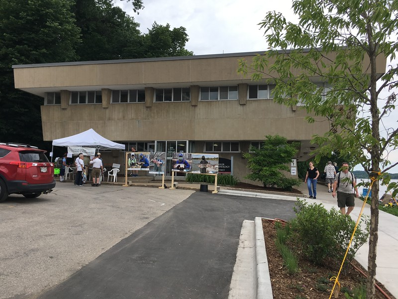 Front of Hasler Lab by parking Lot 8 - Welcome Tent and Photo Op Cutouts