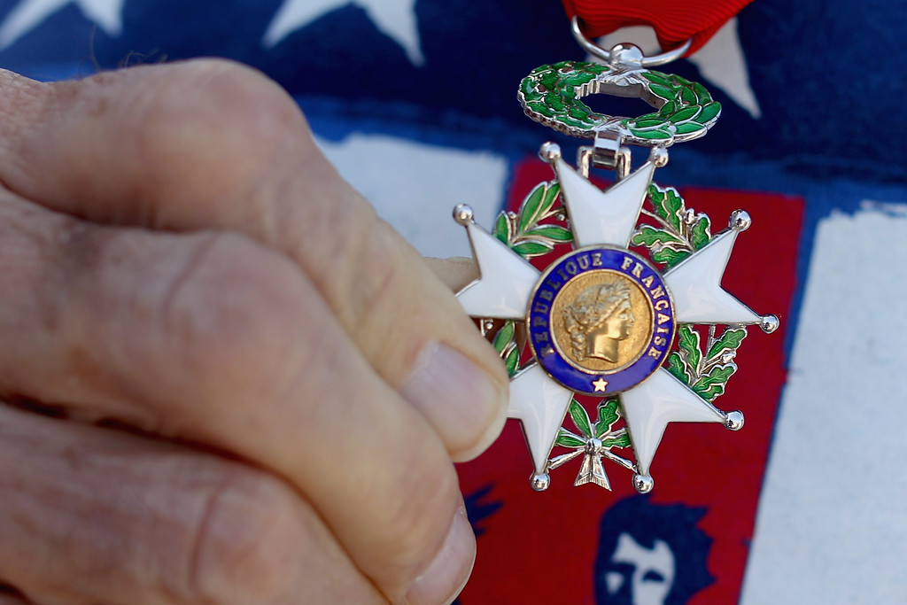 . American World War II veteran Donald Marks, 90, shows his French Legion of Honor Chevalier medal during the 70th anniversary D-Day commemoration at the WWII Memorial on the National Mall June 6, 2014 in Washington, DC. Marks served with the 3104th Signal Service Battalion during the invasion of Normandy by allied troops that turned the tide of the war.  (Photo by Chip Somodevilla/Getty Images)