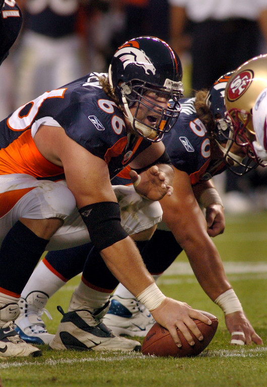 . Bronco center #66 Tom Nalen gets set to hike the ball during the game between the Denver Broncos and the San Francisco 49ers on Saturday night August 20th, 2005 at Invesco Field at Mile High in Denver, Co.      DENVER POST PHOTO BY STEVE DYKES