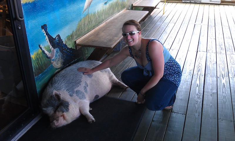Ellen pets Pork Chop, the resident pot-bellied pig at Airboat Rides at Midway