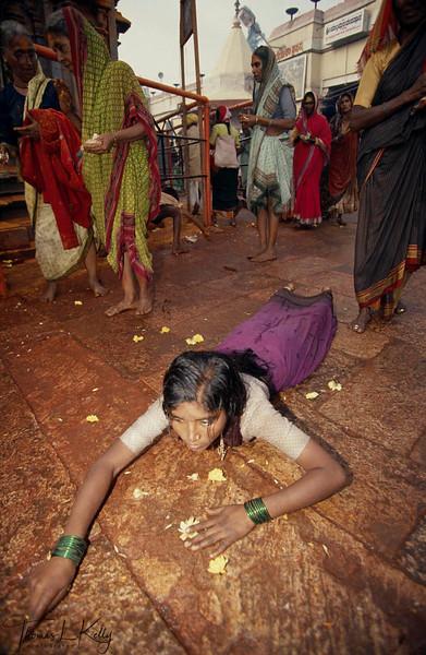 Devotes prostrating Goddess yallama.