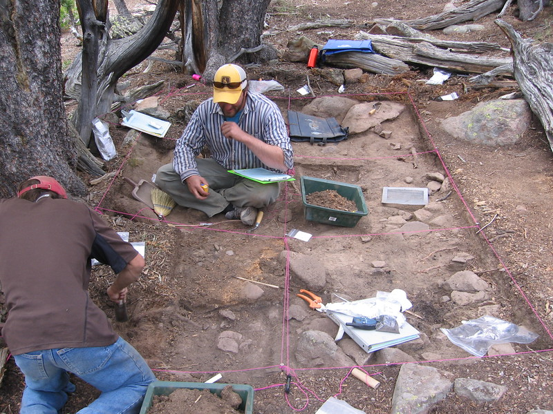 Archaeologists excavate a cut and fill lodge structure at High Rise Village.
