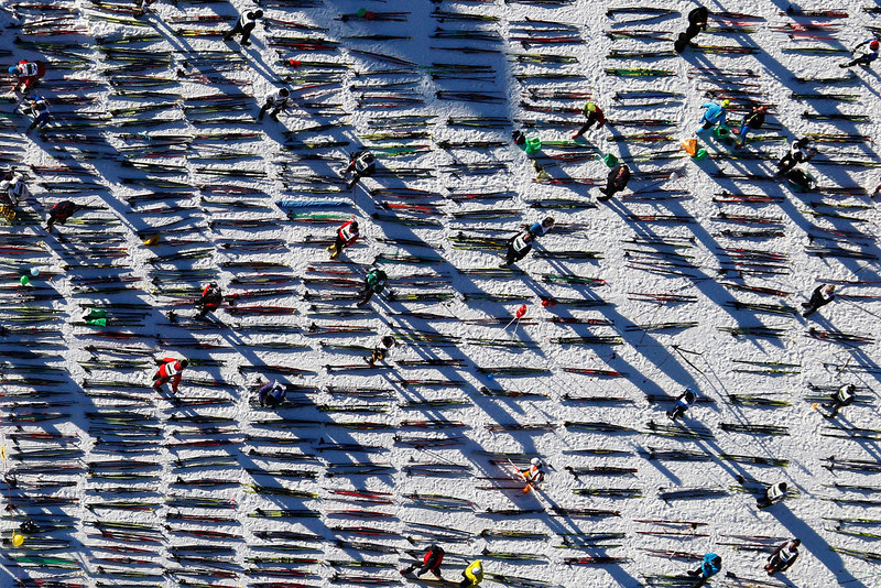 . An aerial view shows cross-country skis placed on the frozen Lake Sils before the start of the Engadin Ski Marathon near the village of Maloja March 10, 2013. More than 12,000 skiers participated in the 26.2 miles race between Maloja and S-chanf near the Swiss mountain resort of St. Moritz. REUTERS/Michael Buholzer