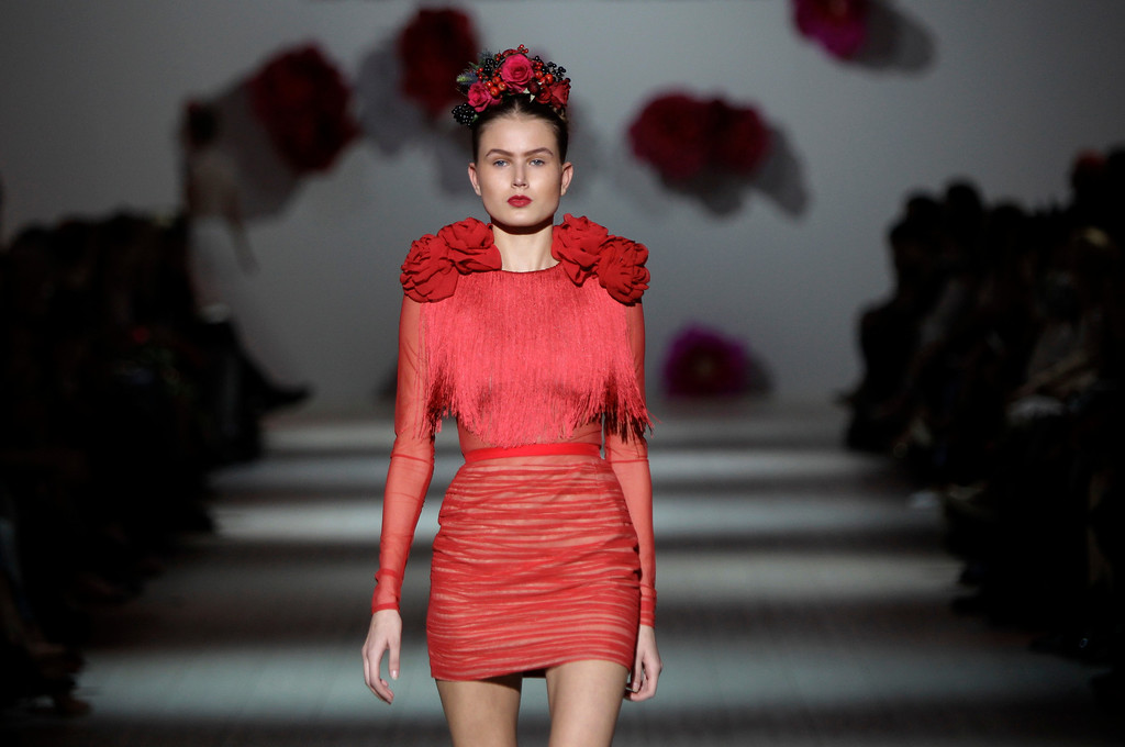 . A model displays outfits by Georgian designer Anouki Bicholla during Ukraine Fashion Week in Kiev, Ukraine, Sunday, Oct. 13, 2013. (AP Photo/Sergei Chuzavkov)