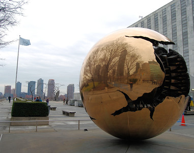 Golden globe, a gift of Italy, reflects the world around it with a view of the East River and beyond.  NO idea of what that sphere is supposed to represent about the Earth