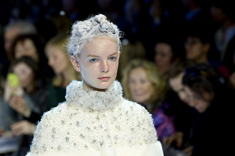 . A model presents a creation by Italian designer Giambattista Valli as part of his Fall-Winter 2013/2014 women\'s ready-to-wear fashion show for fashion house Moncler Gamme Rouge during Paris fashion week March 6, 2013.          REUTERS/Gonzalo Fuentes
