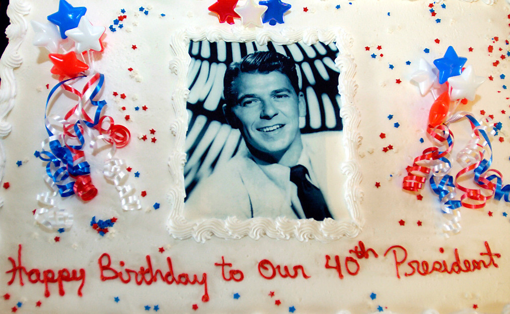 . President Ronald Reagan has his photograph on his birtthday cake to celebrate his 98th birthday at the Ronald Reagan Presidential Library in Simi Valley, Ca. on Friday, Feb. 6, 2009.  (Los Angeles Daily News file photo)