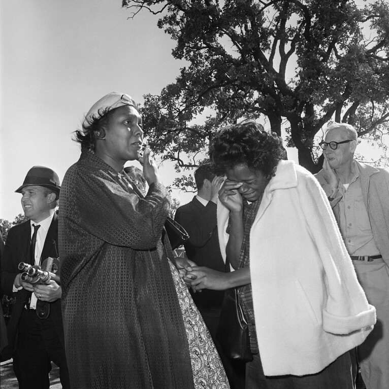 . Two unidentified women burst into tears outside Parkland Hospital on hearing that President John F. Kennedy died from the bullet fired by an assassin while riding in a motorcade in Dallas, Nov. 22, 1963. Gov. John Connally of Texas also shot and in serious condition. (AP Photo)