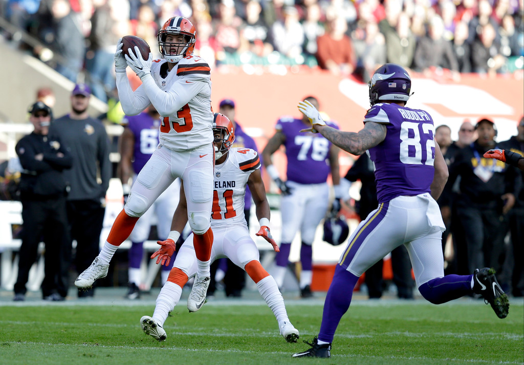. Cleveland Browns linebacker Joe Schobert, left, intercepts a pass as Minnesota Vikings tight end Kyle Rudolph watches during the first half of an NFL football game against Minnesota Vikings at Twickenham Stadium in London, Sunday Oct. 29, 2017. (AP Photo/Tim Ireland)