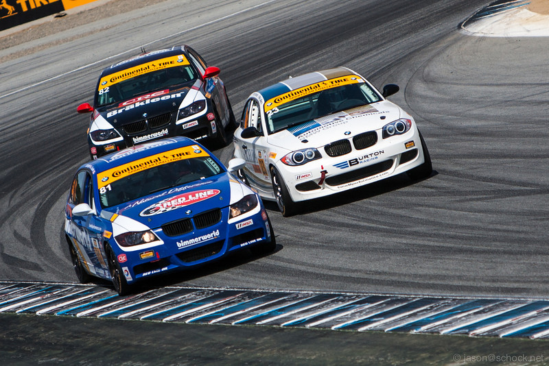 A tight pack of ST BMW's at the final turn of the Continental Tire race.