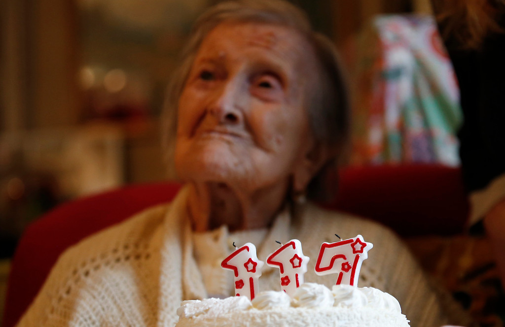 . Emma Morano is pictured behind a cake with candles marking 117 years in the day of her birthday in Verbania, Italy, Tuesday, Nov. 29, 2016.  At 117 years of age, Emma is now the oldest person in the world and is believed to be the last surviving person in the world who was born in the 1800s, coming into the world on Nov. 29, 1899. (AP Photo/Antonio Calanni)