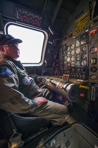 Joe, the copilot, sitting on the flight engineer station.