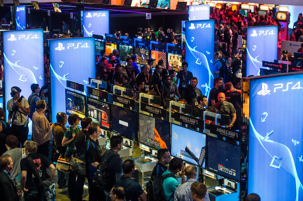 . Attendees interact with newly announced games at the PS4 booth at the Electronic Entertainment Expo in Los Angeles on Tuesday, June 10, 2014. (Photo by Watchara Phomicinda)