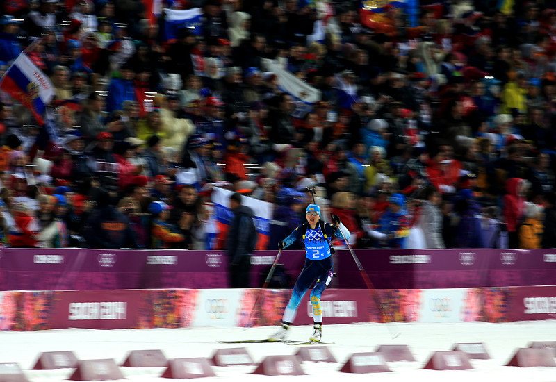 . Gold medalist Olena Pidhrushna of Ukraine approaches the finish line to win the Women\'s 4 x 6 km Relay during day 14 of the Sochi 2014 Winter Olympics at Laura Cross-country Ski & Biathlon Center on February 21, 2014 in Sochi, Russia.  (Photo by Richard Heathcote/Getty Images)