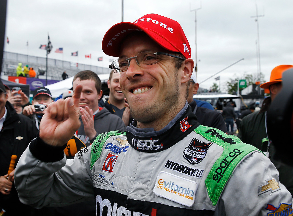 . Sebastien Bourdais celebrates winning the second race of the IndyCar Detroit Grand Prix auto racing doubleheader, Sunday, May 31, 2015, in Detroit. (AP Photo/Paul Sancya)