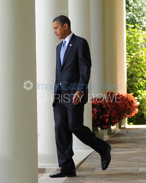 President Barack Obama walks out to the Oval Office following learning he had just won the Nobel Peace Prize .