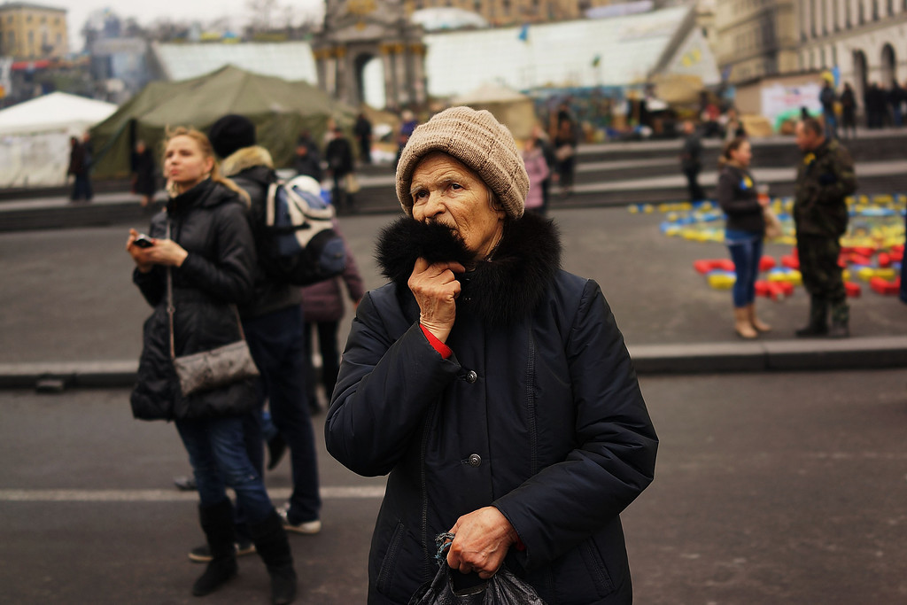 . A woman pauses in Maidan Square, the site of months of often violent protest that led to the ouster of former Ukrainian  president Viktor Yanukovich on March 19, 2014 in Kiev, Ukraine.  (Photo by Spencer Platt/Getty Images)