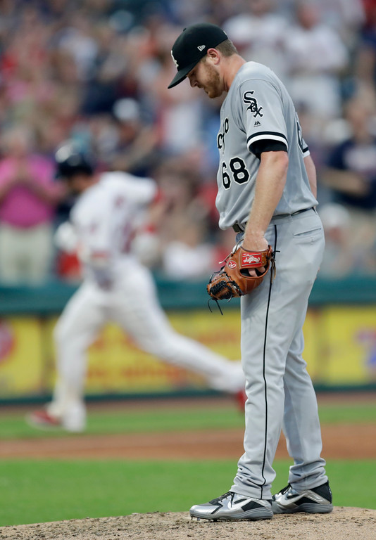 . Chicago White Sox starting pitcher Dylan Covey, right, waits for Cleveland Indians\' Jason Kipnis, left, to run the bases after Kipnis hit a solo home run in the fifth inning of a baseball game, Monday, June 18, 2018, in Cleveland. (AP Photo/Tony Dejak)