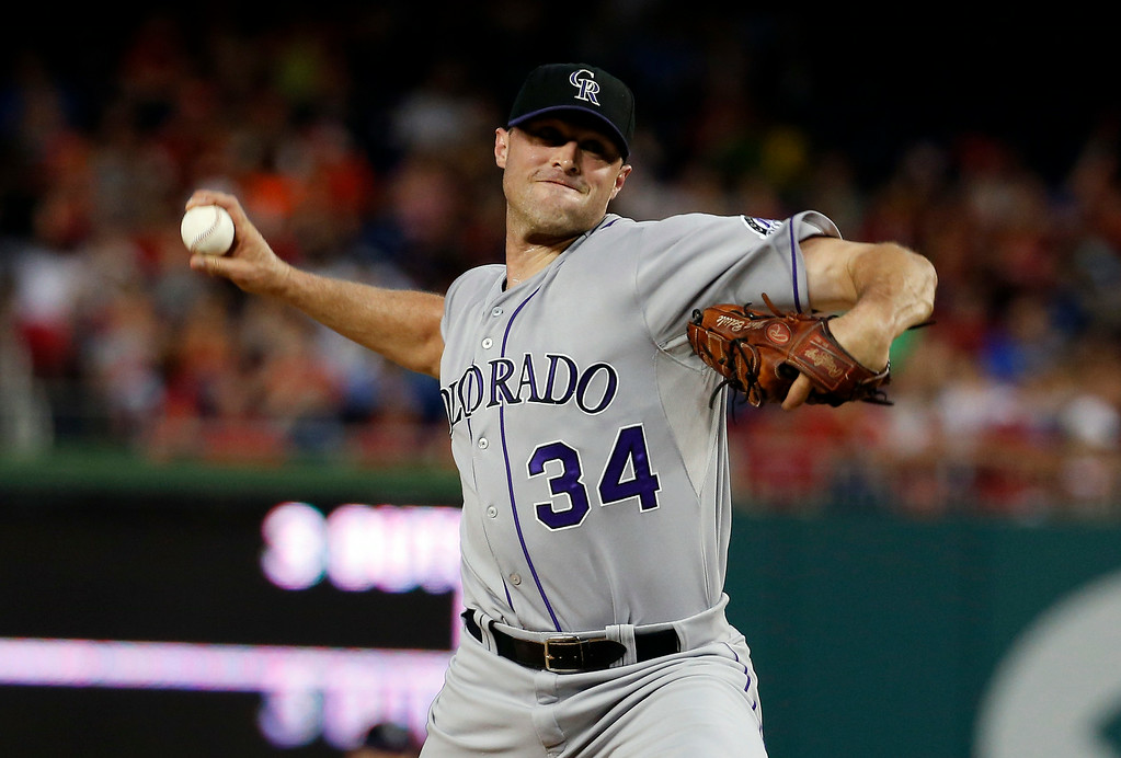 . Colorado Rockies relief pitcher Matt Belisle throws during the seventh inning of a baseball game against the Washington Nationals at Nationals Park, Wednesday, July 2, 2014, in Washington. The Nationals won 4-3. (AP Photo/Alex Brandon)