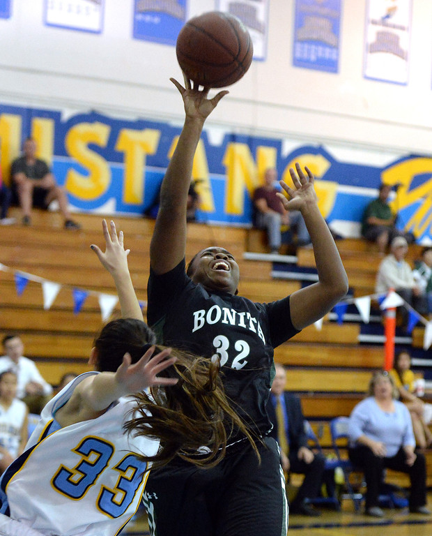 . Bonita\'s Kandyce Smith (32) shoots past Walnut\'s Kim Mayekawa (C) (33) in the first half of a prep basketball game at Walnut High School in Walnut, Calif., on Wednesday, Jan. 15, 2014. Bonita won 60-50. (Keith Birmingham Pasadena Star-News)