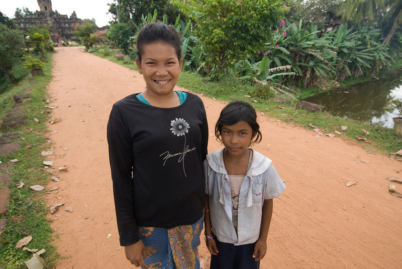 Two orphan girls outside the Angkor Wat Temple in Cambodia