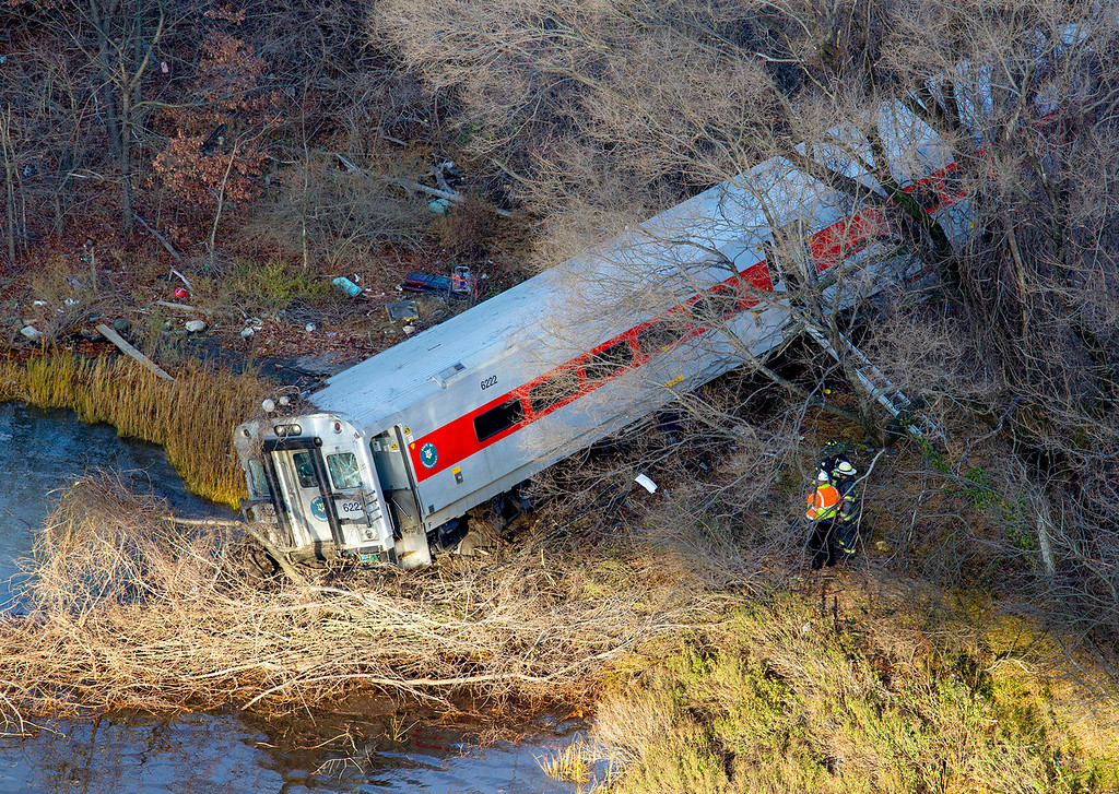 ". First responders view the derailment of a Metro North passenger train in the Bronx borough of New York Dec. 1, 2013. The Fire Department of New York says there are ""multiple injuries\"" in the  train derailment, and 130 firefighters are on the scene. Metropolitan Transportation Authority police say the train derailed near the Spuyten Duyvil station. (AP Photo/Craig Ruttle)"