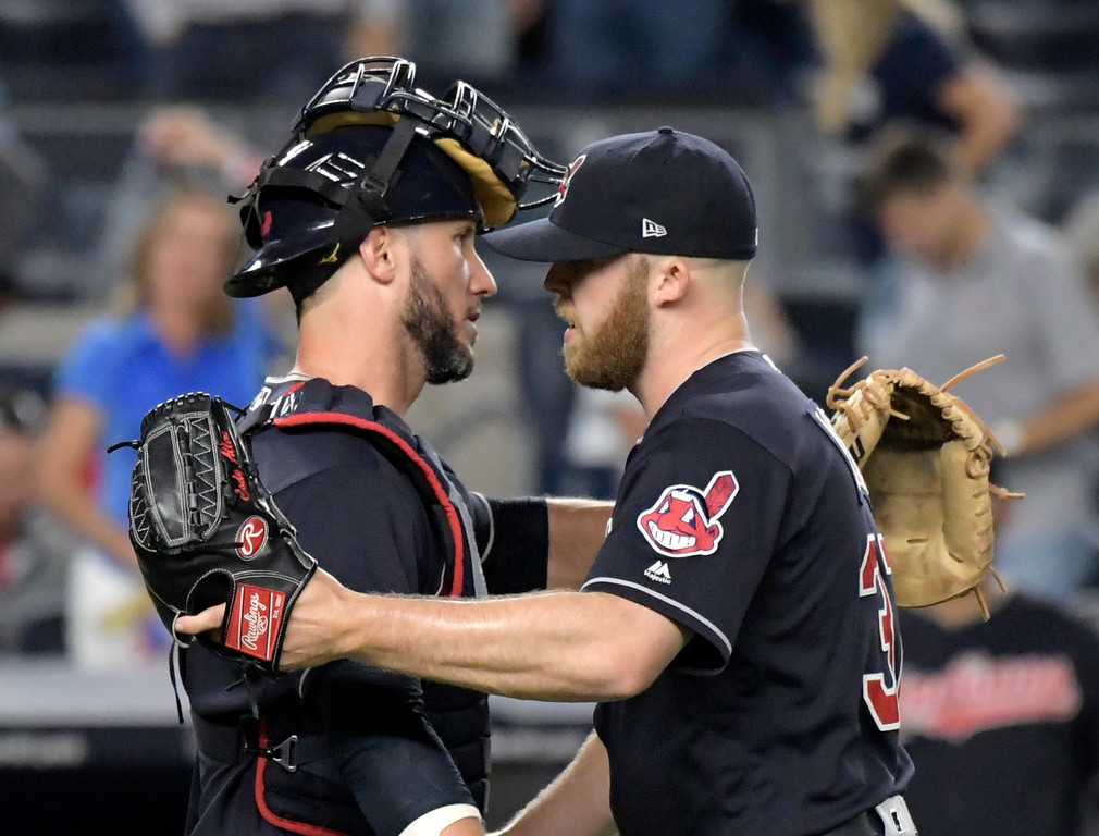 . Cleveland Indians pitcher Cody Allen, right, celebrates with catcher Yan Gomes after the Indians defeated the New York Yankees 6-2 in a baseball game Monday, Aug. 28, 2017, at Yankee Stadium in New York. (AP Photo/Bill Kostroun)