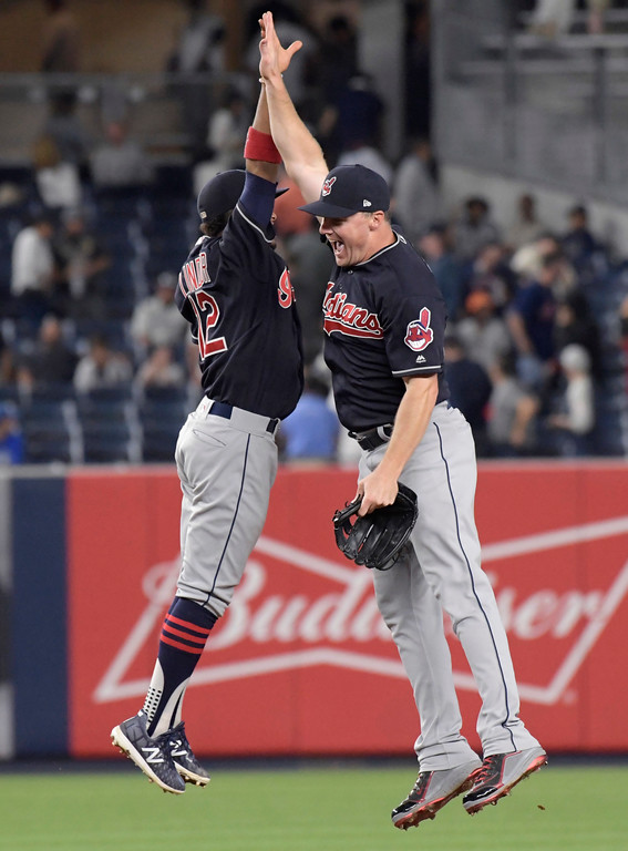 . Cleveland Indians shortstop Francisco Lindor, left, and right fielder Jay Bruce celebrate after the Indians defeated the New York Yankees 6-2 in a baseball game, Monday, Aug. 28, 2017, at Yankee Stadium in New York. (AP Photo/Bill Kostroun)