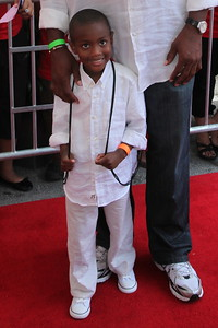 Richard Dent of the 1985 Super Bowl Chicago Bears walks the red carpet with his son Richard Junior during for the Chicago premiere of the Karate Kid at the AMC River East 21 in Chicago, IL,  USA on Wednesday 26, May 2010.