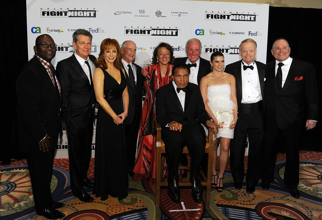 . PHOENIX - MARCH 20:  (L-R) Randy Jackson, David Foster, Reba McEntire, Walter Scott Jr., Lonnie Ali, Muhammad Ali, Jerry Weintraub, Danica Patrick, Celebrity Fight Night Foundation founder Jimmy Walker, and CEO and founder of GoDaddy.com Bob Parsons attend Celebrity Fight Night XVI on March 20, 2010 at the JW Marriott Desert Ridge in Phoenix, Arizona.  (Photo by Michael Buckner/Getty Images for Celebrity Fight Night)