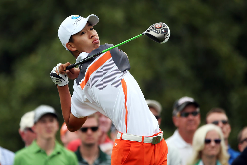Description of . Tianlang Guan of China tees off on the 10th hole during the final round of the 2013 Masters Tournament at Augusta National Golf Club on April 14, 2013 in Augusta, Georgia.  (Photo by Andrew Redington/Getty Images)