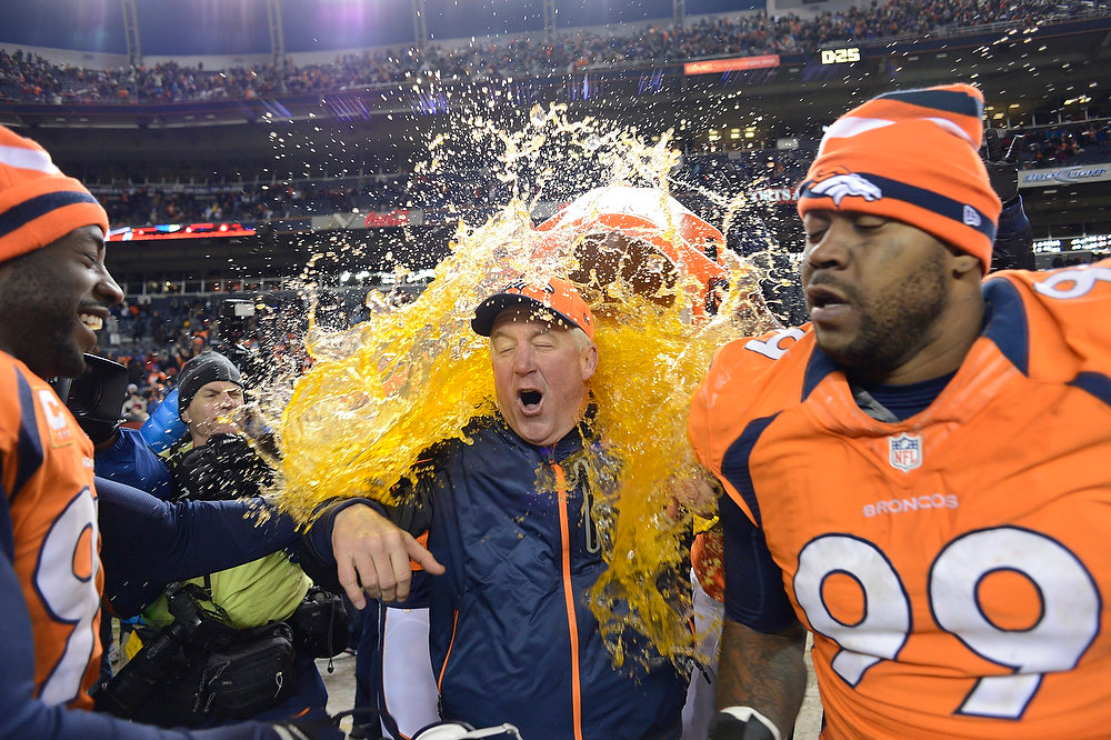 Description of . Denver Broncos head coach John Fox gets doused at the end of the game as the Denver Broncos took on the Kansas City Chiefs at Sports Authority Field at Mile High in Denver, Colorado on December 30, 2012. John Leyba, The Denver Post
