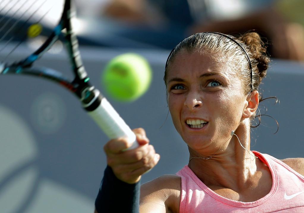 . Sara Errani, of Italy, returns a shot to Olivia Rogowska, of Australia, during the first round of the 2013 U.S. Open tennis tournament, Tuesday, Aug. 27, 2013, in New York. (AP Photo/Darron Cummings)