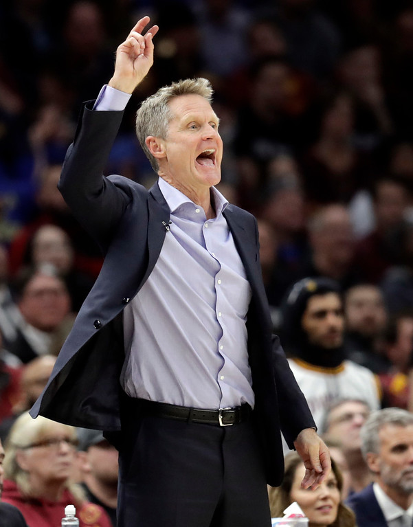 . Golden State Warriors head coach Steve Kerr yells instructions in the first half of an NBA basketball game against the Cleveland Cavaliers, Monday, Jan. 15, 2018, in Cleveland. (AP Photo/Tony Dejak)