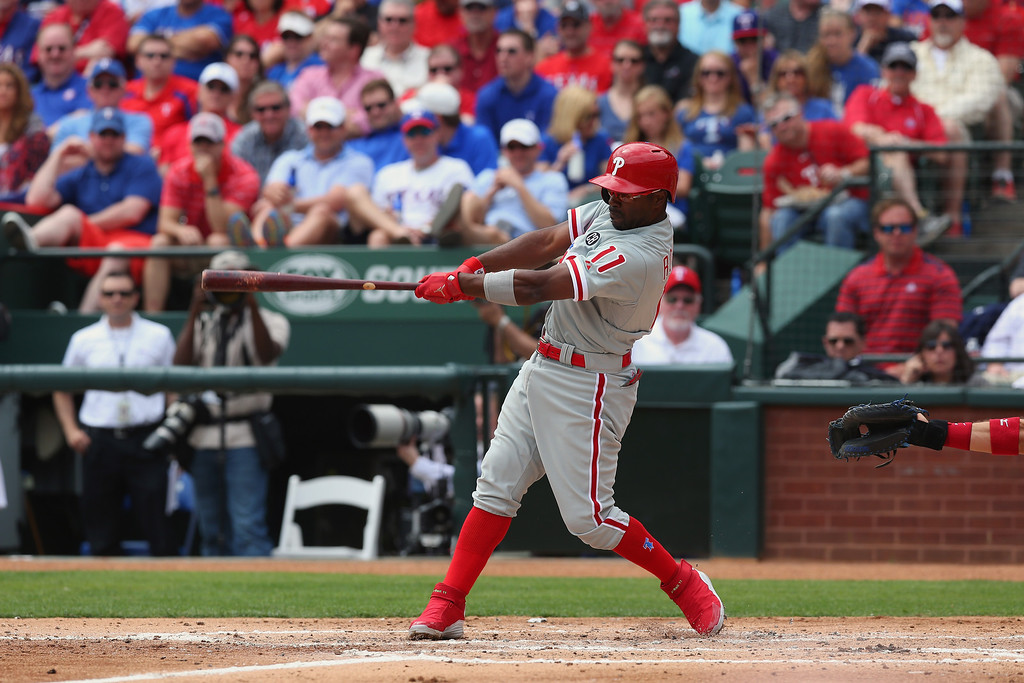 . Jimmy Rollins #11 of the Philadelphia Phillies hits a grand slam against the Texas Rangers in the second inning during the MLB Opening Day game at Globe Life Park in Arlington on March 31, 2014 in Arlington, Texas.  (Photo by Ronald Martinez/Getty Images)