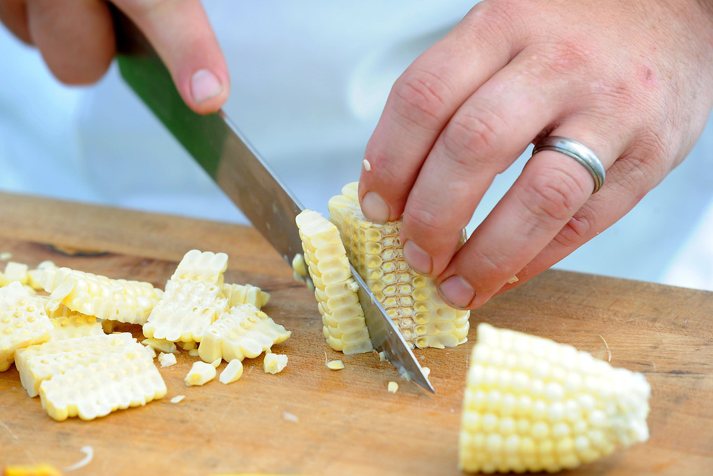 ". Matt Greco, the Chef at Livermore\'s Wente Vineyards restaurant, cuts off kernels of corn during the ""Alameda County Mayors\' Healthy Cook-Off Challenge\"" held at the Dublin Farmers\' Market at Emerald Glen Park in Dublin, Calif., on Thursday, July 25, 2013. The Livermore team, consisting of Greco and Livermore Mayor John Marchand, went on to take first place advancing them to compete against the winners of the Contra Cost County Mayors\' Healthy Cook-Off Challenge. The contest will be held at Mt. Diablo High School in the fall. The cook-off was presented by Concord\'s Wellness City Challenge and promotes the importance of healthy eating. (Doug Duran/Bay Area News Group)"